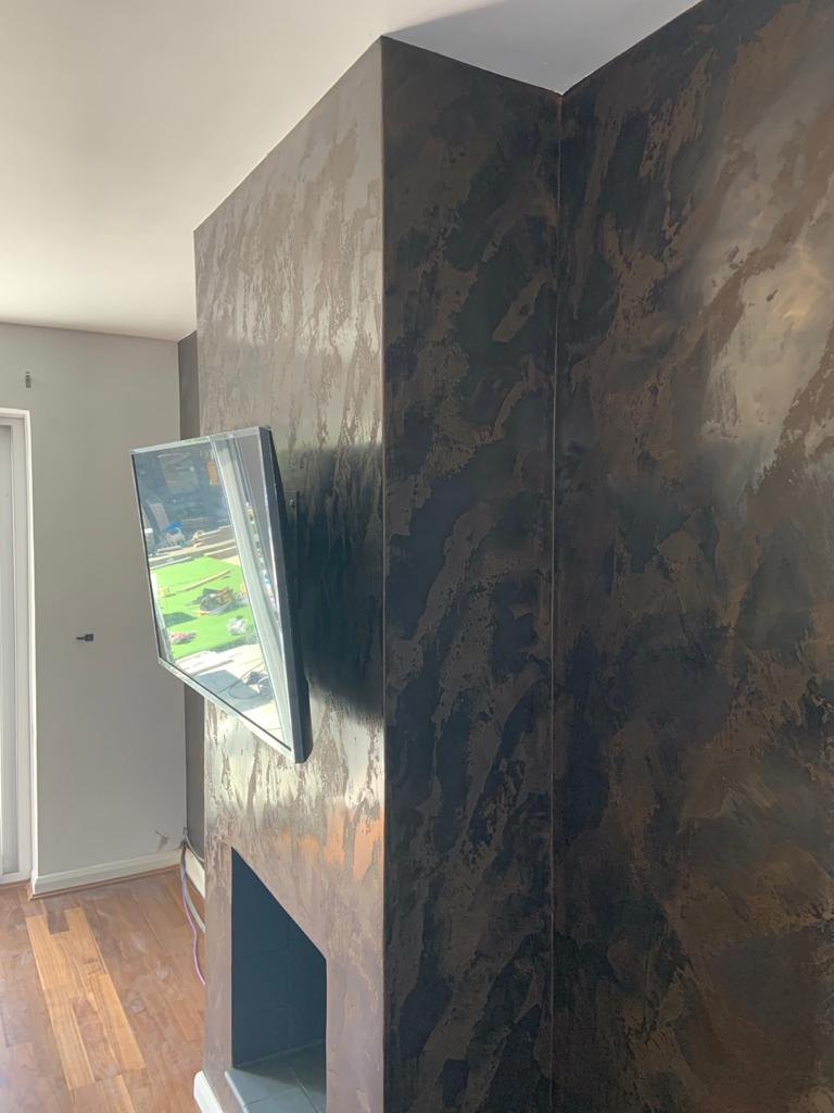 Venetian Plaster Surrey - Black and gold Venetian Plaster TV feature wall - Ultra Finishes