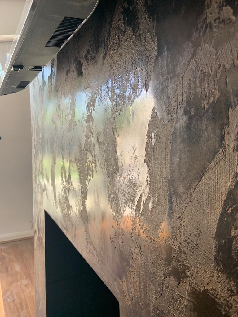 Venetian Plaster Surrey - Black and gold Venetian Plaster TV feature wall by Ultra Finishes