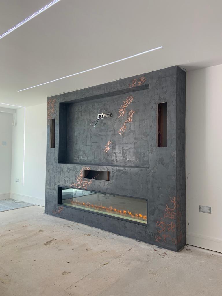 Venetian Plaster Surrey - Luxury black and gold detailed Venetian Polished Plaster Fireplace - Ultra Finishes